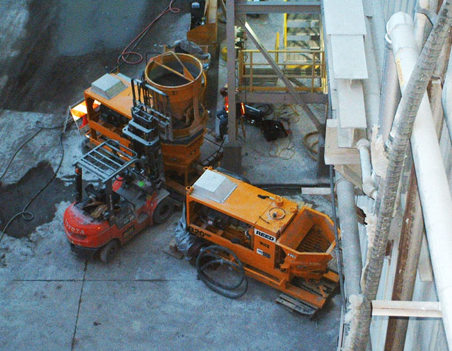 two electric shotcrete pumps on site for spraying refractory